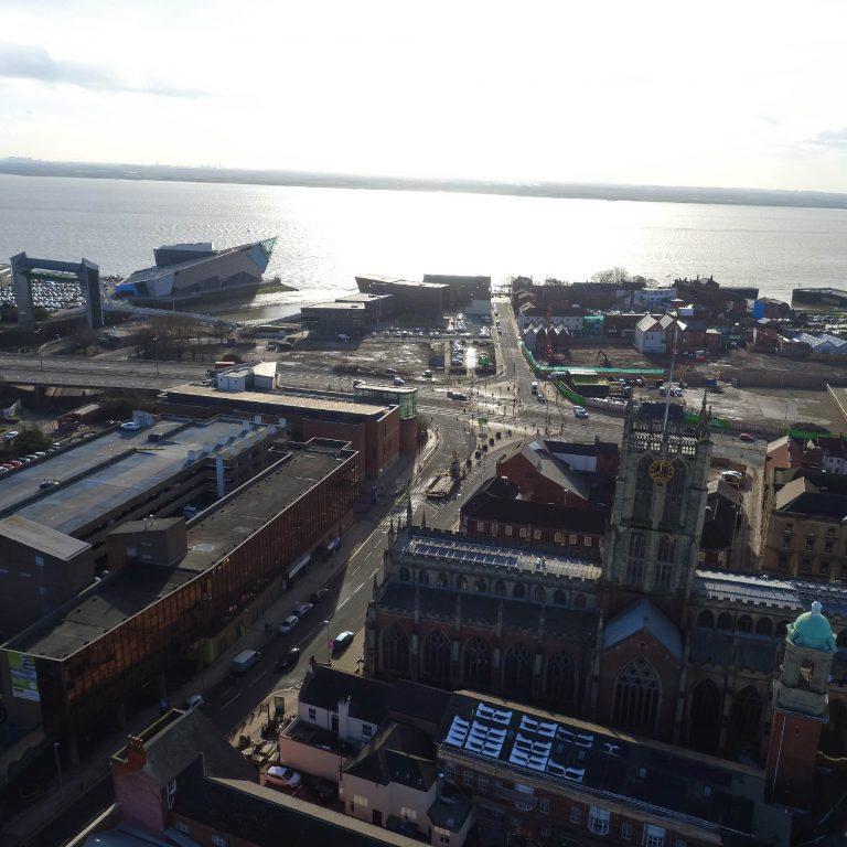 A photograph of Hull taken from a drone. You can see buildings in the town centre, The Deep aquarium, and the sunlight reflecting on the Humber River.
